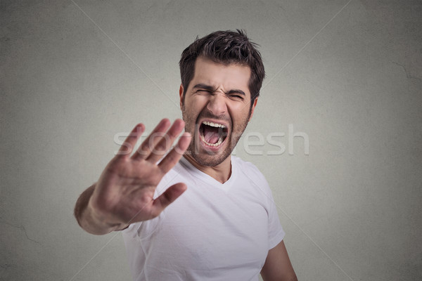 portrait of young angry man screaming to stop stay away  Stock photo © ichiosea