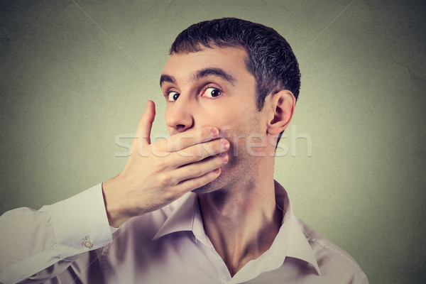 Headshot of a scared adult man with hand covering his mouth  Stock photo © ichiosea