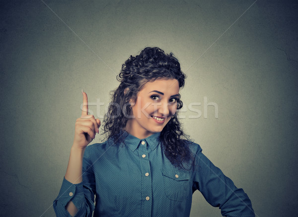 young woman has idea, pointing with finger up looking happy Stock photo © ichiosea