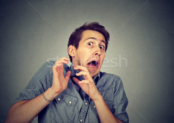 man looking shocked scared trying to protect himself from unpleasant  Stock photo © ichiosea