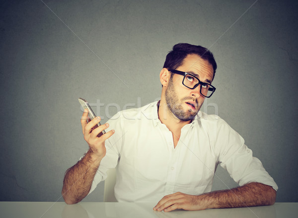 Stock photo: annoyed man with cellphone. Long wait times, horrible conversations