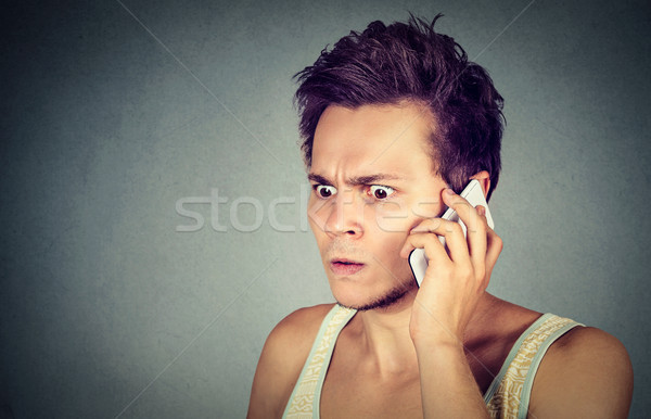 Frustrated, pissed of by someone listening on mobile phone Stock photo © ichiosea