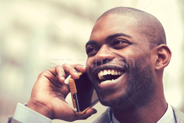 счастливым смеясь молодые бизнесмен говорить мобильного телефона Сток-фото © ichiosea