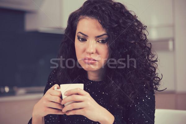 Beautiful young woman looking depressed Stock photo © ichiosea