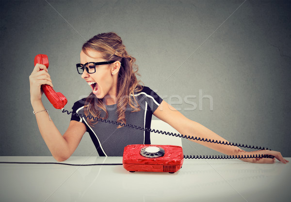 Young woman yelling on the red phone Stock photo © ichiosea