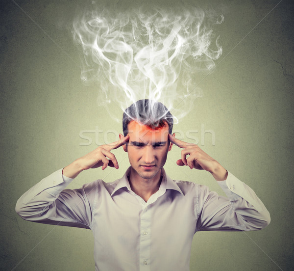 man thinks very intensely having headache. human face expression  Stock photo © ichiosea