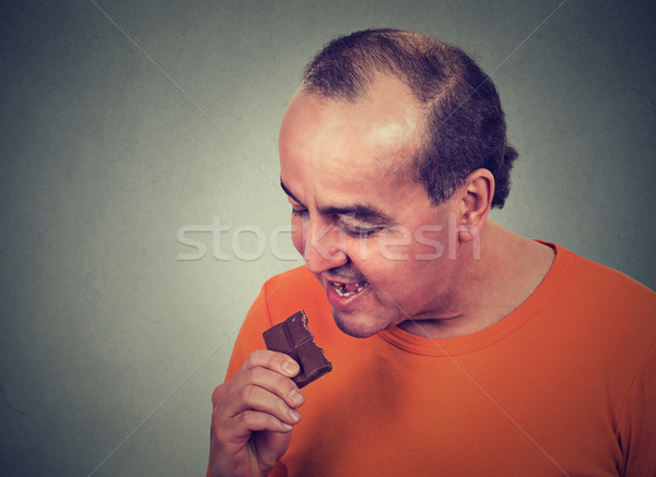 man tired of diet restrictions craving sweets chocolate Stock photo © ichiosea