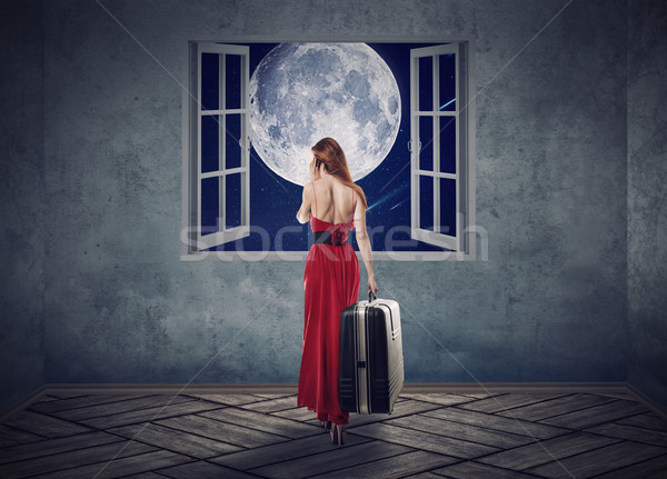 Beautiful woman in red dress walking to opened window with moon Stock photo © ichiosea