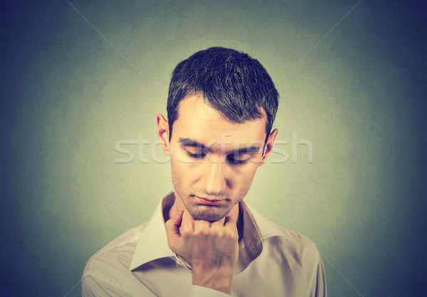 sad lonely young man looking down has no motivation in life depressed  Stock photo © ichiosea