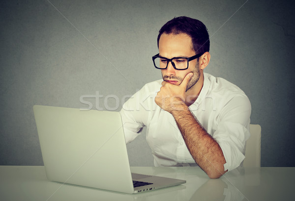 Young man using a laptop computer  Stock photo © ichiosea