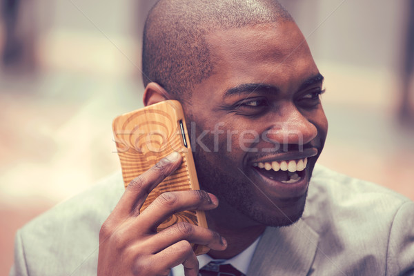 Boldog nevet fiatal üzletember beszél mobiltelefon Stock fotó © ichiosea