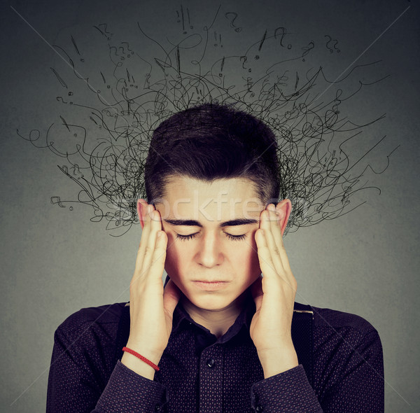 worried stressed man with brain melting into lines question marks  Stock photo © ichiosea