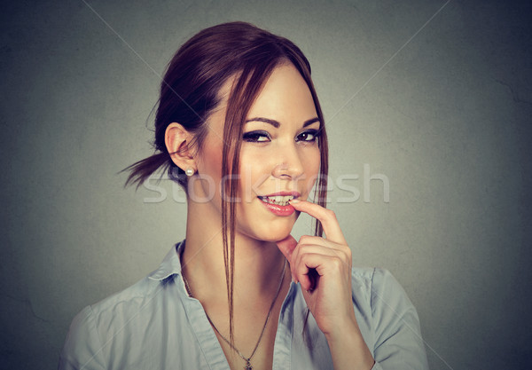 smiling flirting woman with finger on lip  Stock photo © ichiosea