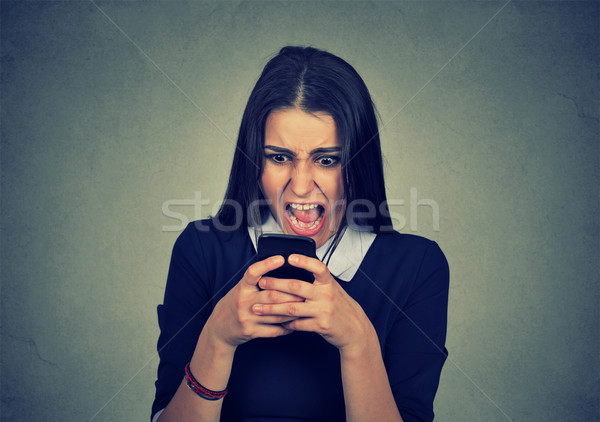 Portrait angry young woman screaming on mobile phone Stock photo © ichiosea