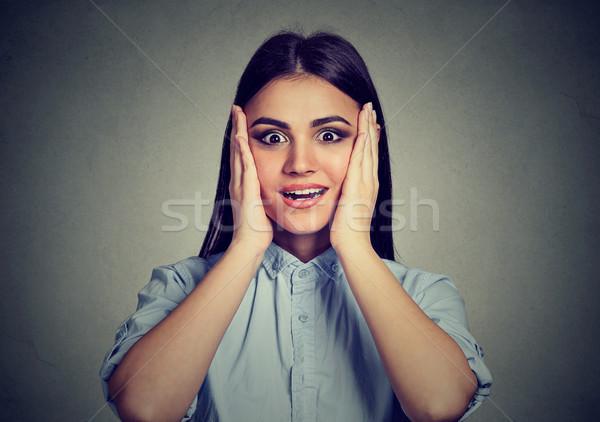 étonné jeune femme mains joues gris heureux Photo stock © ichiosea
