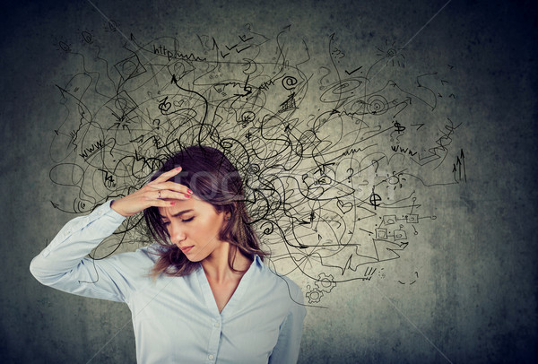 Thoughtful stressed woman with a mess in her head Stock photo © ichiosea
