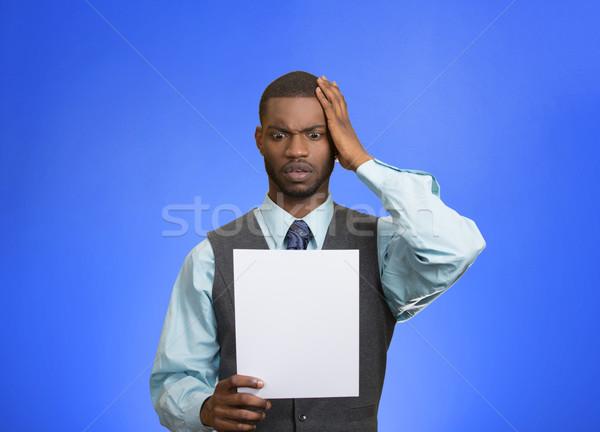 Hombre papel conmocionado malas noticias primer plano Foto stock © ichiosea