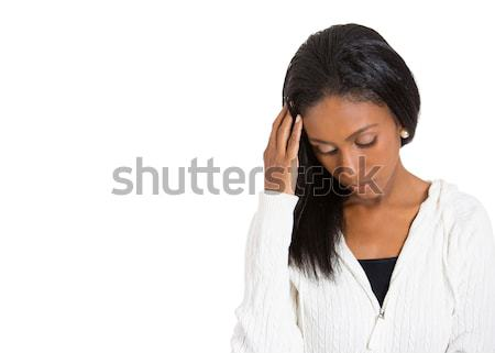 unhappy sad stressed woman looking down away thinking Stock photo © ichiosea