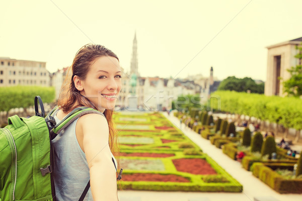 Happy woman in Brussels downtown extending you arm inviting to visit Mont des Arts garden  Stock photo © ichiosea