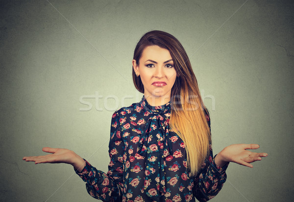 young woman shrugging shoulders Stock photo © ichiosea