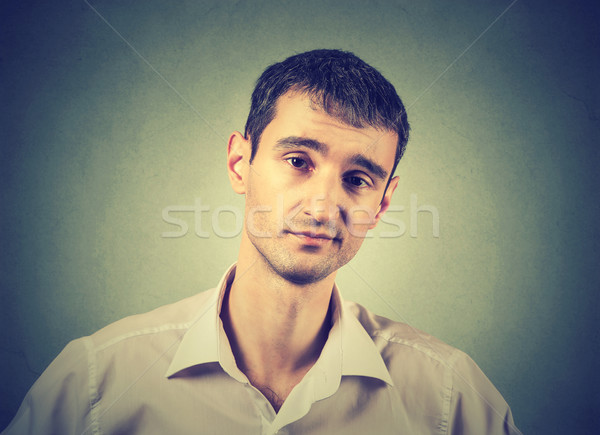 skeptical man looking with disapproval on his face. Stock photo © ichiosea