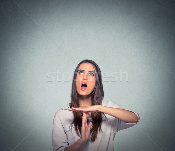Woman showing time out hand gesture, frustrated screaming to stop  Stock photo © ichiosea
