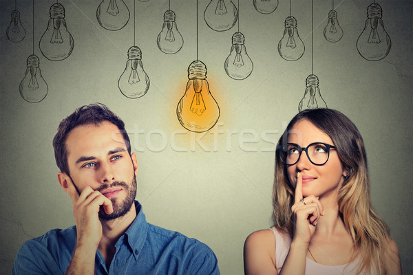 Cognitive skills male vs female. Man and woman looking at light bulb  Stock photo © ichiosea