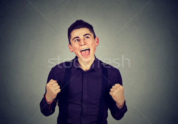Boldog sikeres diák férfi nyerő ünnepel Stock fotó © ichiosea