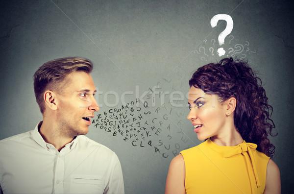 Hombre hablar mujer atractiva signo de interrogación Pareja nino Foto stock © ichiosea
