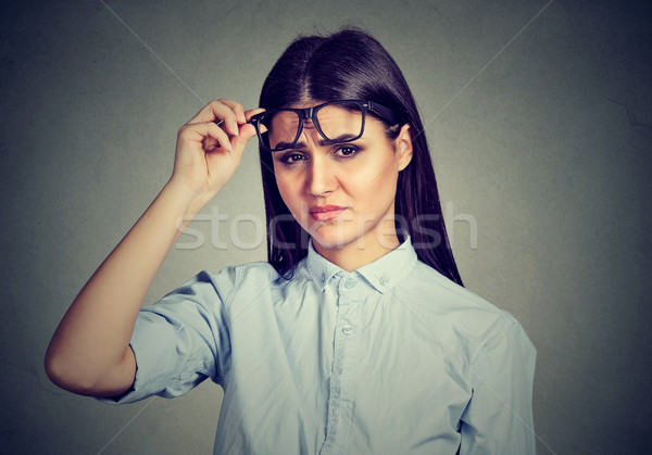 Stock photo: confused skeptical woman looking at you with disapproval