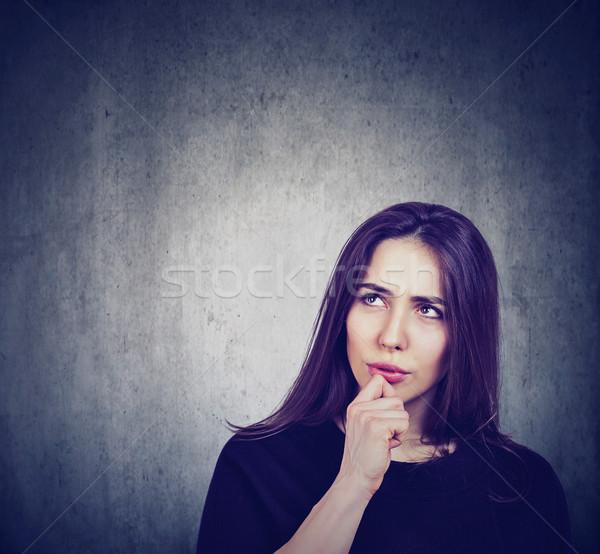 Zamyślony zamyślony kobieta tablicy działalności dziewczyna Zdjęcia stock © ichiosea