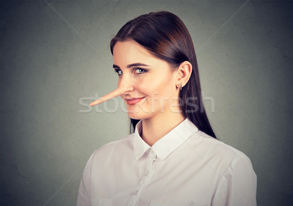 Stock photo: Liar sly funny looking woman