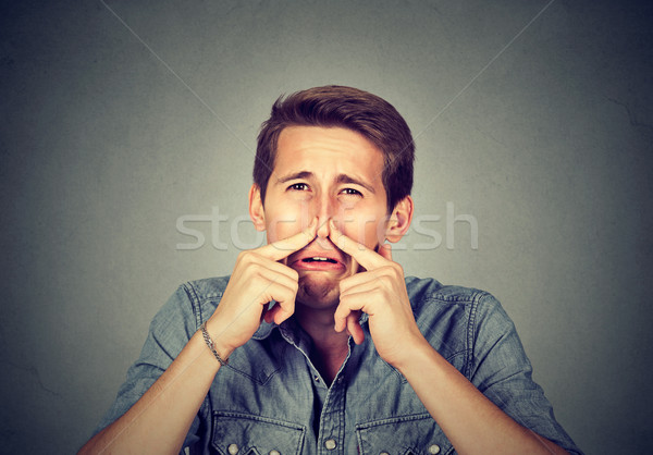 man pinches nose looks with disgust something stinks bad smell  Stock photo © ichiosea