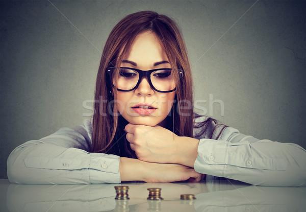 честолюбивый деловой женщины глядя растущий монетами Сток-фото © ichiosea
