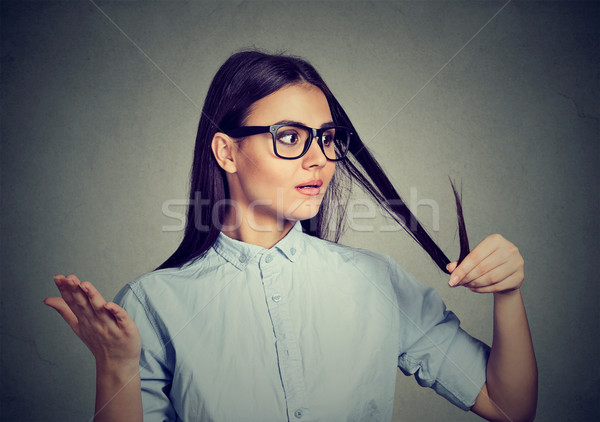 Unhappy woman surprised she is losing hair, receding hairline Stock photo © ichiosea