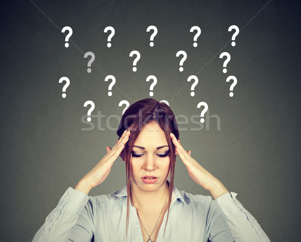 Anxious stressed woman with question marks  Stock photo © ichiosea