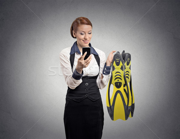 woman looking at smartphone holding diving gear Stock photo © ichiosea