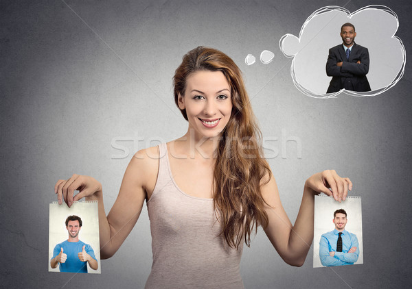 Beautiful woman undecided about which man to choose. Human emotions Stock photo © ichiosea