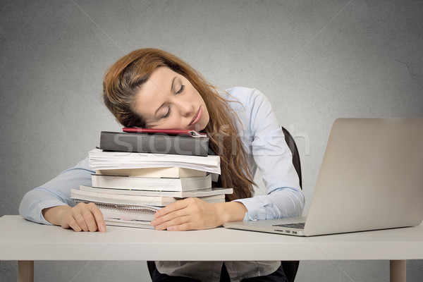 woman sleeping on books at her desk Stock photo © ichiosea