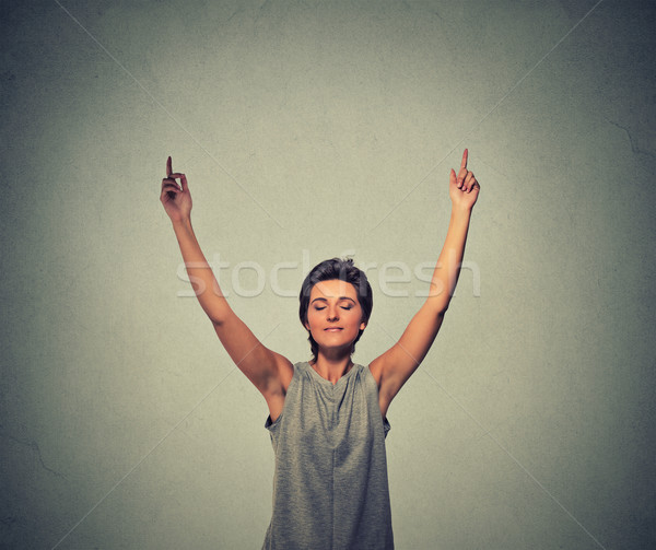 woman raising her arms in victory Stock photo © ichiosea