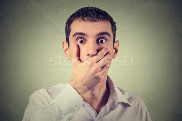 scared young man with hand over his mouth, stunned and speechless Stock photo © ichiosea