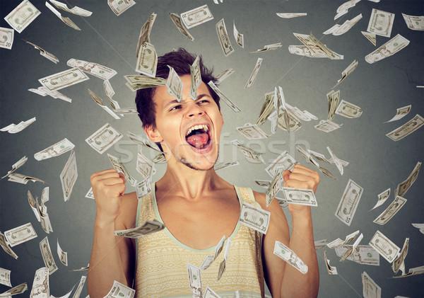 Man succes geld regen vallen beneden Stockfoto © ichiosea
