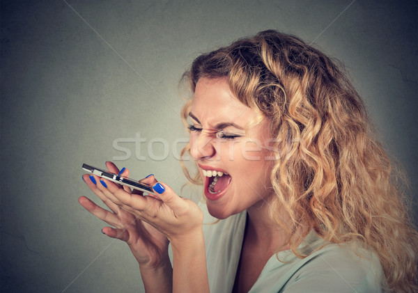Stock photo: woman screaming on mobile phone