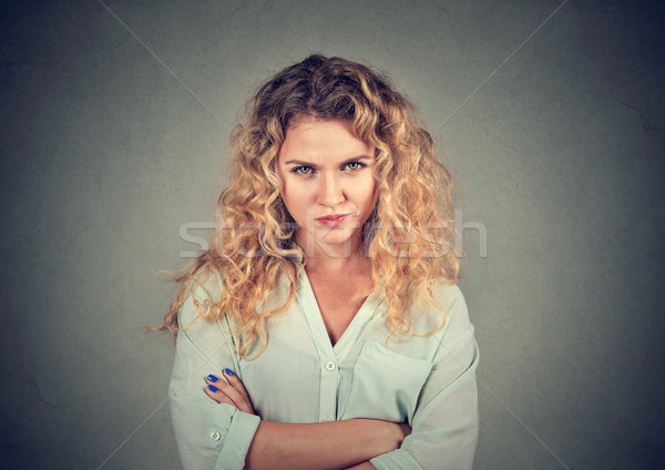 Stock photo: Displeased pissed off angry grumpy pessimistic woman with bad attitude