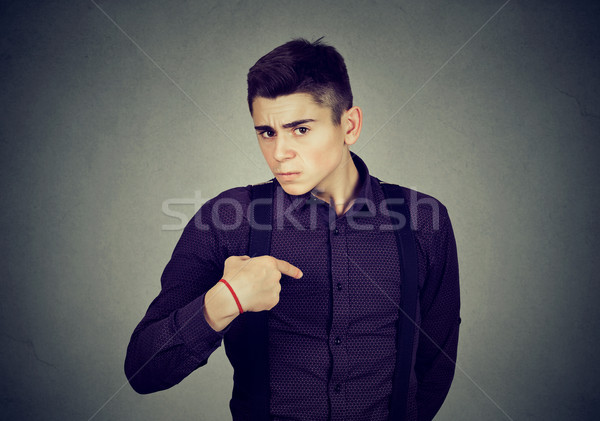 angry guy pointing finger at himself you mean me Stock photo © ichiosea