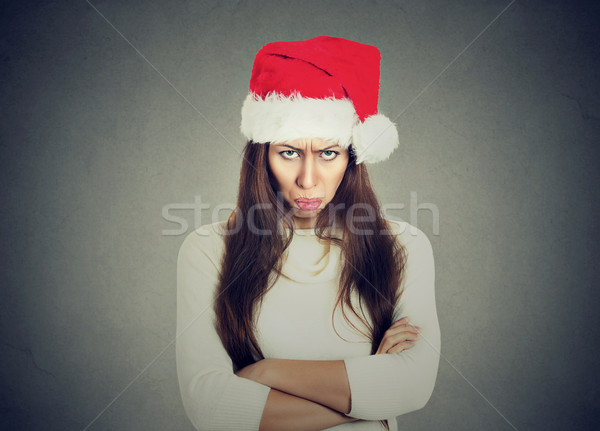 Upset woman in santa claus hat arms crossed looking at you  Stock photo © ichiosea