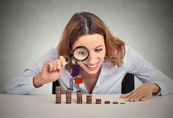 Stock photo: Woman looking at corporate employee walking up coin stack ladder