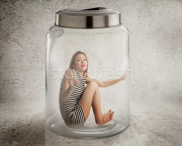 Young lonely woman sitting in glass jar  Stock photo © ichiosea