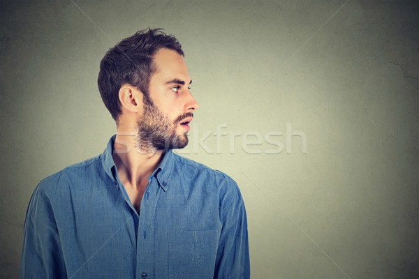 profile of handsome man on gray background Stock photo © ichiosea
