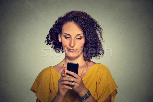 upset skeptical unhappy serious woman talking texting on phone  Stock photo © ichiosea